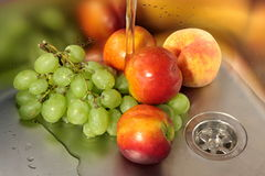Washing fruits Royalty Free Stock Images