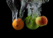 Washing fruits Stock Image
