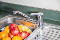 Washing fruits stock photos
