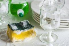 Washing glasses and plates Stock Photo