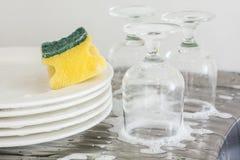 Washing glasses and plates Royalty Free Stock Image