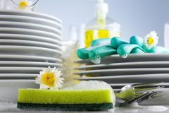 Washing glasses and plates Stock Photos