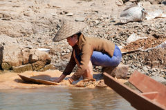 Washing gold in the river Royalty Free Stock Images