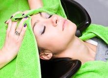 Washing hair. Woman washing hair in hair salon Stock Photo