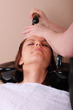 Washing hair. Stock Images