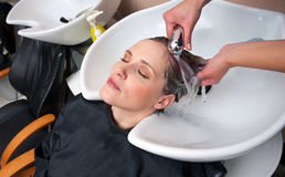 Washing hair Stock Images