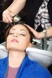 Washing hair Stock Images