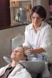 Washing hair in hair salon Stock Photos