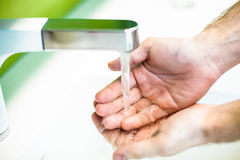 Washing hand under tap water Stock Photos