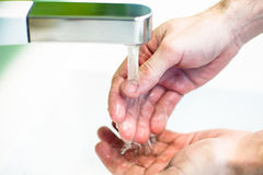 Washing hand under tap water Royalty Free Stock Photography