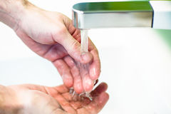 Washing hand under tap water Royalty Free Stock Photos