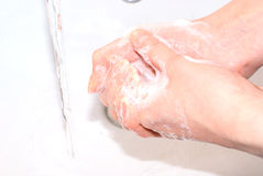 Washing of hands. Process of washing of hands with soap under a water stream. A series hygiene Stock Photography