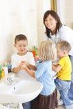 Washing hands. Preschoolers in bathroom washing hands royalty free stock photos