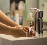 Washing hands close-up faucet, tile Royalty Free Stock Photos