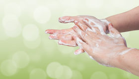 Washing hands. Hygiene concept. Green bokeh background. Royalty Free Stock Photos