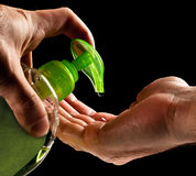 Washing hands with liquid soap royalty free stock images