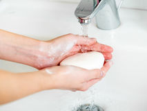 Washing of hands with soap in bathroom Royalty Free Stock Images