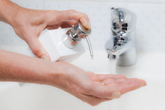Washing Hands With Soap and Water Stock Photo