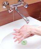 Washing of hands under running water Stock Photos