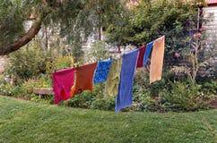 Washing hanging on clothesline Stock Photo