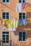 Washing hanging outside an old building of Lisbon, Portugal Royalty Free Stock Photography