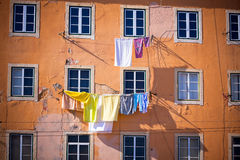 Washing hanging outside an old building of Lisbon, Portugal Stock Images
