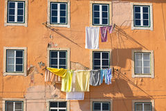 Washing hanging outside an old building of Lisbon, Portugal Royalty Free Stock Photo
