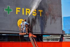 Washing at hatch cover ship and cleaning of Cargo ship in floating dock by high pressure water jet stock photography