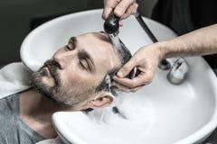Washing head in barbershop Stock Image