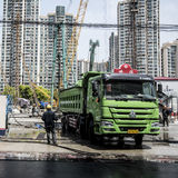 Washing heavy vehicle at construction site, Shanghai Stock Images
