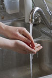 Washing Her Hands.jpg Royalty Free Stock Images