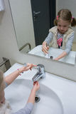Washing her little hands Royalty Free Stock Photos