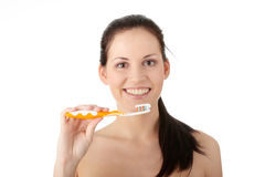 Washing her teeth Stock Photo