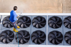 Washing the industrial premises. Worker washing the industrian premises Stock Photography