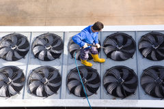 Washing the industrial premises. Worker washing the industrian premises Stock Photo