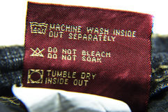 Washing Information for Jeans. Wash jeans with instructions supplied with it. The tag is attached with the cloth and can be used for guidlines royalty free stock images