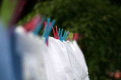 Washing Line. Clothes with pegs on washing line Stock Images