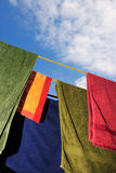 Washing line. Brightly colored washing on a clothes line Royalty Free Stock Images