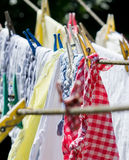 Washing on the line. With colorful pegs Royalty Free Stock Image