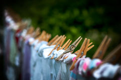 Washing line. Eco-friendly - washing line, clothes and pegs. Shallow depth of field Royalty Free Stock Photography