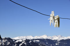 Washing line. Plastic clothes pegs on washing line with the Dolomites in the background Royalty Free Stock Photos