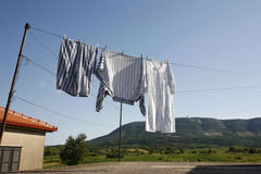 Washing line. Clothes hanging on the washing line to dry in summer Stock Images