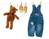 Washing Line. Teddy bear on washing line with sneakers and dungarees Royalty Free Stock Photo