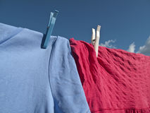 Washing on Line - Blue Sky. Washing hanging on a line with a lovely blue sky royalty free stock images