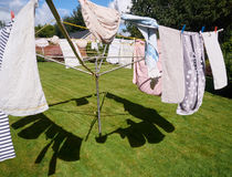 Washing line with clothes. Moving in the wind Royalty Free Stock Photos