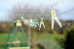 Washing Line. An empty washing line with pegs Royalty Free Stock Photo