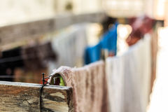 Washing line laundry drying. Outdoors in the garden. Natural outdoors clothes drying Royalty Free Stock Photo