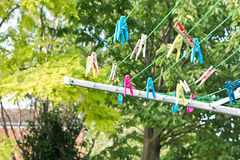 Washing line. Part of a washing line with coloful plastic clohes pegs Stock Images