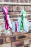 Washing Line with Pegs. Pink and green washingline pegs. Cleaning. Washing clothes Royalty Free Stock Photography