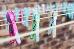 Washing Line with Pegs. Washingline pegs pink green white. Washing clothes. Cleaning Stock Image